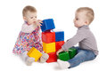Boy and girl playing with cubes isolated on white Royalty Free Stock Photo