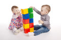 Boy and girl playing with cubes isolated on white Stock Image