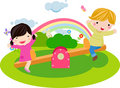 Boy and girl playing seesaw Stock Photo