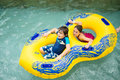 Boy and girl in a pool tube at jay peak s waterpark Royalty Free Stock Image