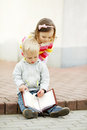 Boy and girl reading a book Royalty Free Stock Photo