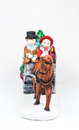 boy and girl riding the Horsecar ,Christmas decoration ceramics, earthenware isolated on white background... Royalty Free Stock Photo