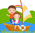 Boy and girl sailing on lake Stock Photography