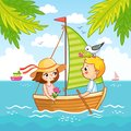 Boy and a girl are sailing on a sailboat on the sea. Royalty Free Stock Photo