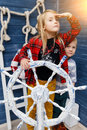 Boy , girl in sea helm Royalty Free Stock Photo