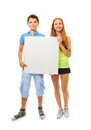 Boy and girl with sign Royalty Free Stock Photo
