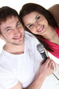 Boy and girl singing into a microphone Stock Photos