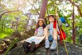 Kids rest during hike boy and girl with map Royalty Free Stock Photo