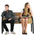 Boy and girl sitting on a bench Stock Photo