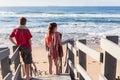 Boy Girl Stairs Beach Waves Royalty Free Stock Photo