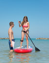 Boy and girl on stand up paddle Royalty Free Stock Photo