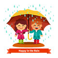 Boy and girl standing in the rain under umbrella Royalty Free Stock Photo