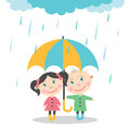 Boy and girl standing in the rain under umbrella.