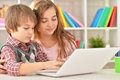 Boy and girl using laptop Royalty Free Stock Photo