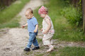 Boy and girl walk together summer outdoors Stock Photography