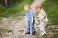 Boy and girl walk together summer outdoors Stock Images
