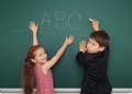 Boy and girl write on school board Royalty Free Stock Photo