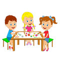 Boy and girls draw at the table