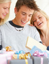 Boy with girls looking at gifts Stock Photography