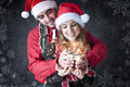 Boy give a Christmas gift to her girlfriend. Royalty Free Stock Photos