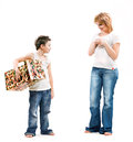 Boy gives her mother a holiday gift surprise on white background isolated for Stock Photos