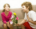 Boy giving bouquet to girl Royalty Free Stock Photo