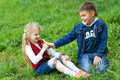 Boy giving flowers to a girl