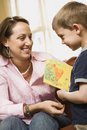 Boy giving mom a drawing. Royalty Free Stock Photography