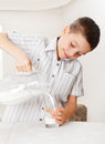 Boy with glass pitcher milk child drinking for breakfast Royalty Free Stock Photography