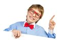 Boy with glasses holding a white placard and bow tie pointing up his finger Stock Photography
