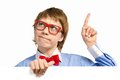 Boy with glasses holding a white placard and bow tie pointing up his finger Royalty Free Stock Images