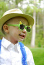 Boy with glasses a little wears plastic sun Royalty Free Stock Images