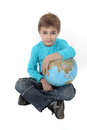Boy with a globe in his lap Stock Photography