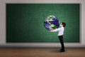 Boy with a globe of the world Royalty Free Stock Photo