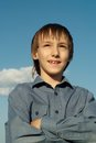 Boy go to the nature teenager smiling under sky dotted with clouds Royalty Free Stock Image