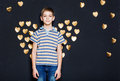 Boy with golden heart wings on dark background Royalty Free Stock Photo