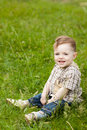 Boy on grass Royalty Free Stock Images