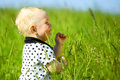 Boy in grass little play green Royalty Free Stock Image