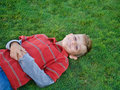 Boy on green grass. Royalty Free Stock Photos