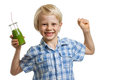 Boy with green smoothie flexing muscles a cute holding a bottle of or juice is his and smiling isolated on white Stock Image