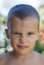 Boy grimaces portrait of a frowning Stock Photos