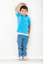 Boy growing tall Royalty Free Stock Photo