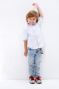 Boy growing up tall happy to be leaning against the wall Royalty Free Stock Photo