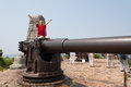 Boy on a gun in the old russian fort lyushyun name port arthur east china Stock Photo