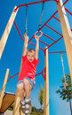 Boy on the gymnastic rings tired ans scared Stock Images