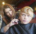 Boy haircut getting his at a popular salon and barbershop Royalty Free Stock Image