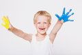 Boy with hands painted in colorful paints ready to make hand prints. School. Preschool. Education. Creativity. Studio portrait ove Royalty Free Stock Photo