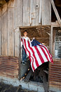 Boy hanging American flag Stock Photo