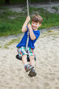 Boy hanging on swing rope active little Royalty Free Stock Images