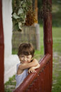 Boy happy on the porch of an old house Royalty Free Stock Photo